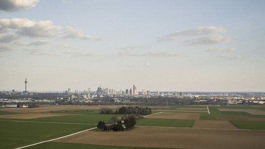Rural farmland with city of Frankfurt in backgroundy