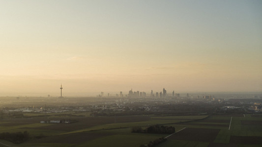 Sunset over Frankfurt skyline and rural farmland