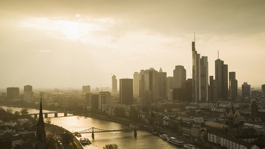 Sunset over Frankfurt cityscape and River Main