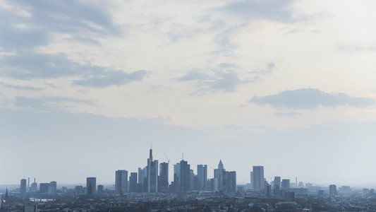 Frankfurt cityscape under cloudy sky