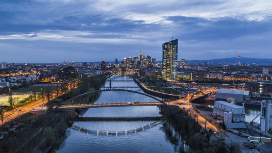 Frankfurt cityscape and bridges over River Main at night