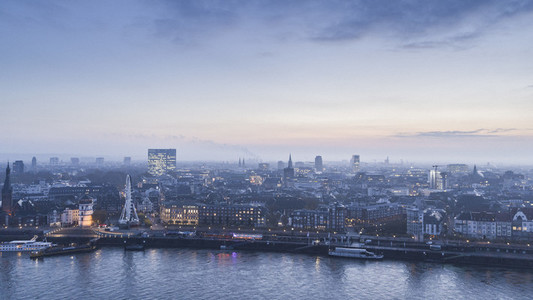 Tranquil Duesseldorf cityscape and Rhine River at dusk