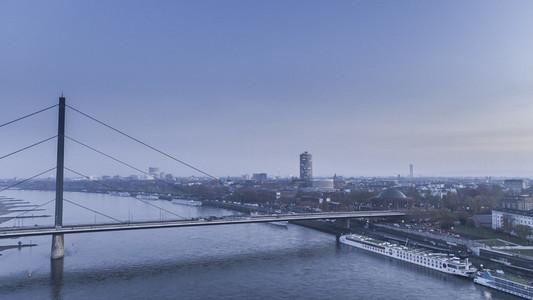Rhine Knee Bridge and Duesseldorf cityscape at dusk