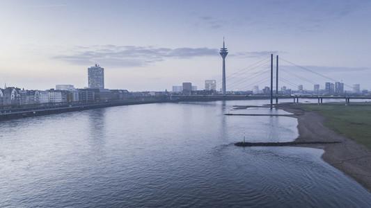 Rhine River and Rhine Tower at dusk