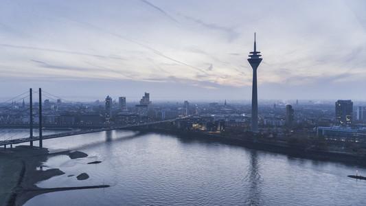 Rhine Tower and Rhine River at dusk