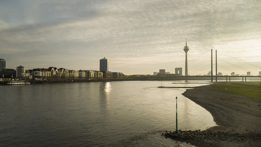 Tranquil Rhine River and Rhine Tower at sunset