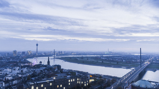 Rhine River and cityscape at dusk