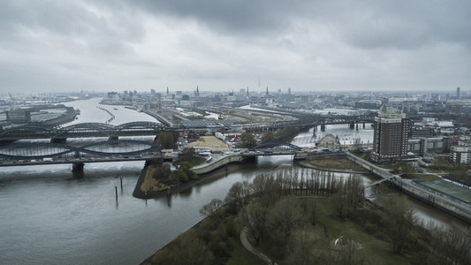 Scenic Hamburg cityscape and Elbe River under overcast sky