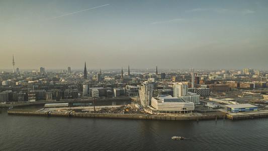 Sunny Hamburg cityscape along Elbe River