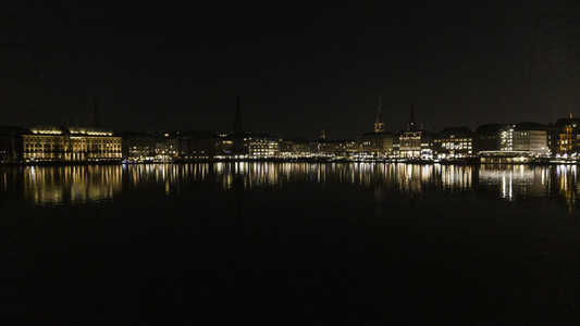 Hamburg cityscape illuminated in Elbe River at night