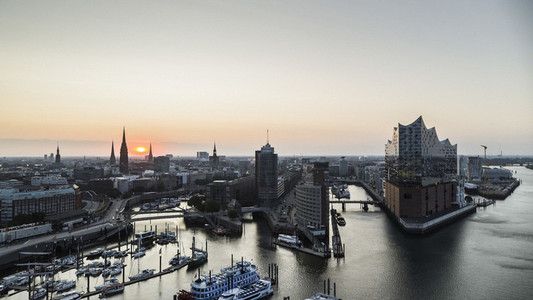 Scenic view Hamburg cityscape and Elbe River at sunset