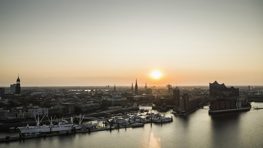 Sunset over tranquil Hamburg cityscape and Elbe River