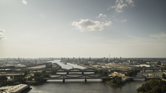 Sunny scenic view Hamburg and bridges over Elbe River