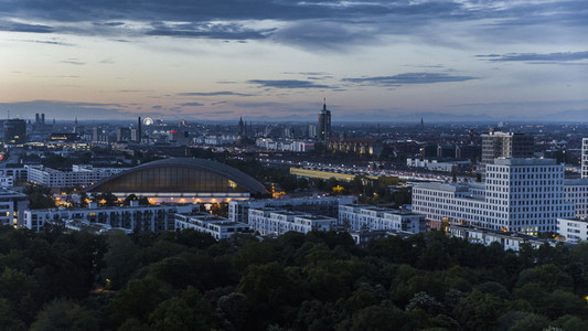 Munich cityscape and Hirschgarten at dusk