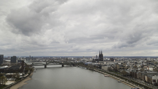 Clouds over Cologne cityscape and Rhine River