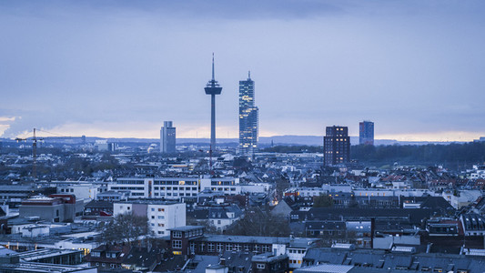 Colonius TV Tower above Cologne cityscape at dusk