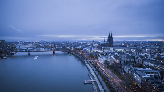 Scenic Rhine River and Cologne cityscape at dusk