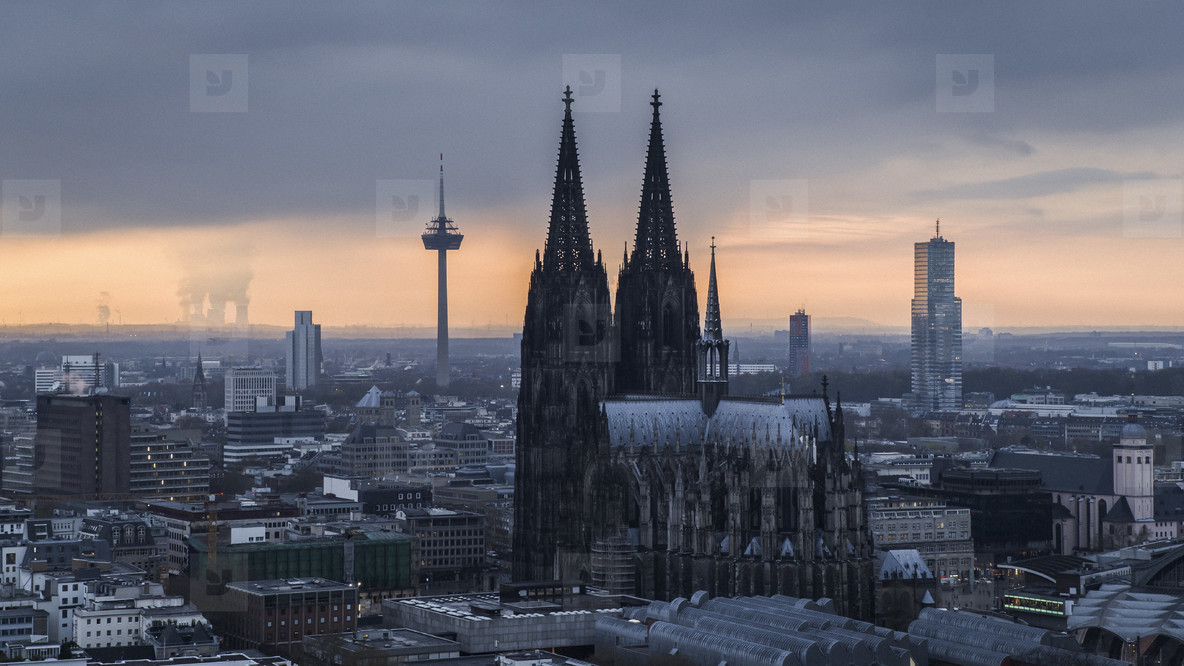 Cologne Cathedral and Colonius TV Tower at sunset