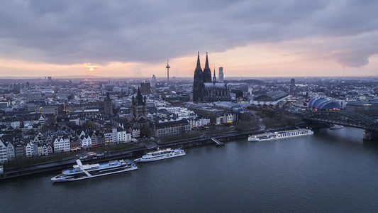 Scenic Cologne cityscape and Rhine River at sunset