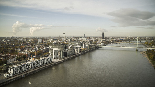 Sunny Rhine River and Cologne cityscape