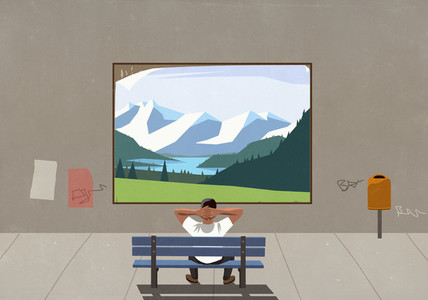Man on bench watching landscape on urban billboard
