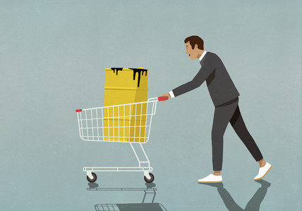 Businessman pushing oil barrel in shopping cart