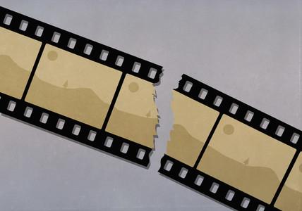Ripped camera film negative of landscape