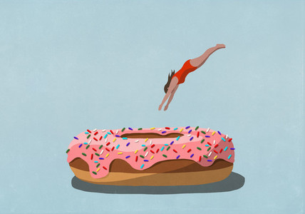 Woman diving into large sprinkled donut