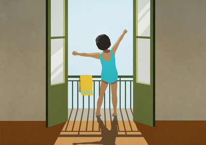 Girl in bathing suit stretching arms on sunny balcony