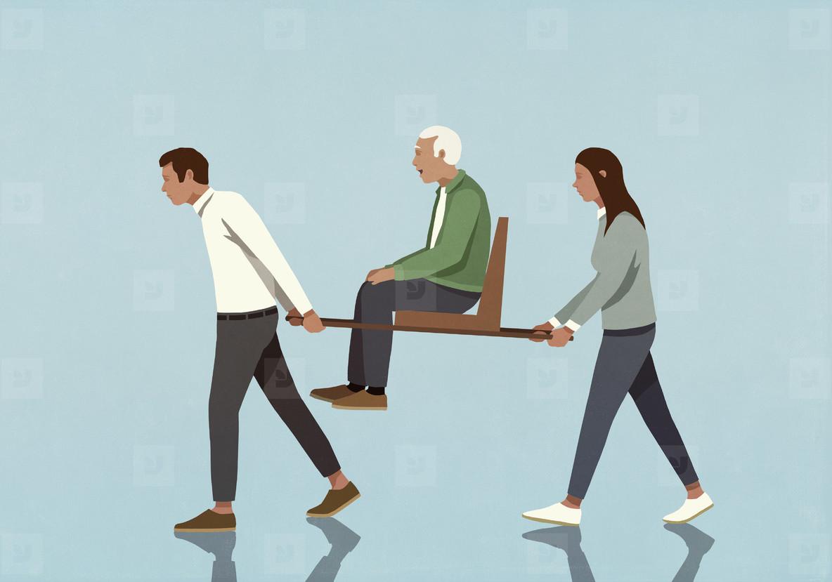 Couple carrying senior man on sedan chair