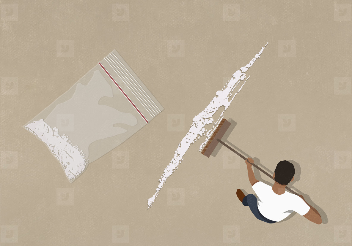 Man sweeping up cocaine with broom