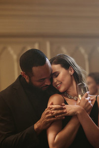 Beautiful young couple dancing at a gala party