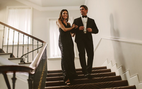 Beautiful couple walking down the stairs
