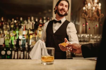 Man making a cashless payment at nightclub bar