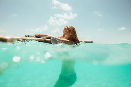 Woman enjoying surfing in the sea