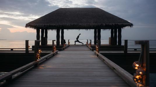 Yoga on an overwater villa on sea