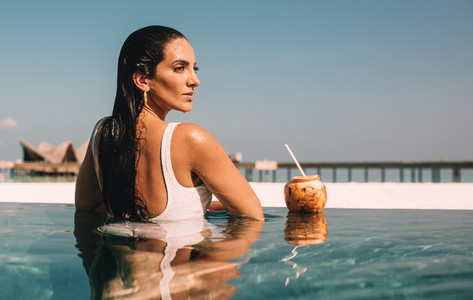 Woman on a luxury holiday at a tropical resort