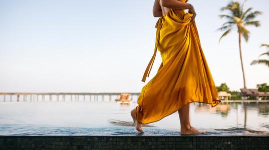 Woman walking near a swimming pool