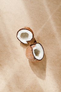 Summer abstract creative composition with coconut a on kraft paper