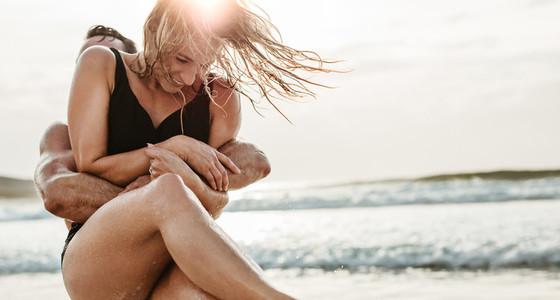 Couple enjoying themselves on the beach