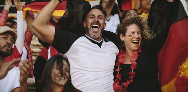 German football team cheering their teams victory