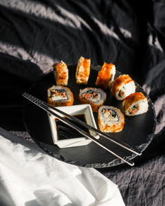 Sushi roll and soy sauce