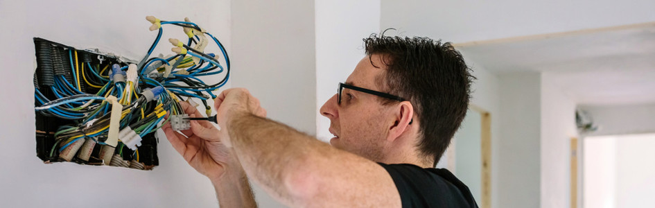Electrician working on the electrical installation of a house