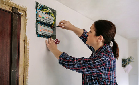 Electrician working on the distribution panel of a house