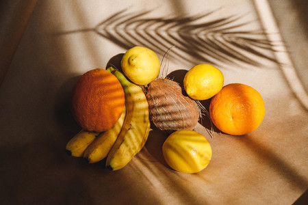 Creative summer food still life with bananas  coconut  oranges and lemons