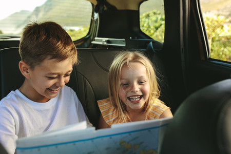 Kids  playing with map in car