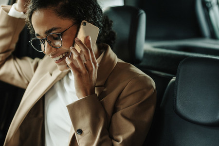 Businesswoman traveling to work and talking on phone