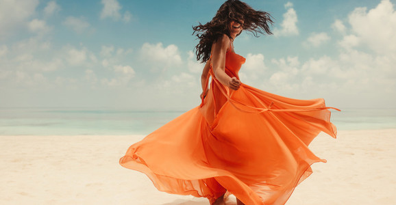 Portrait of a woman on holiday enjoying on beach