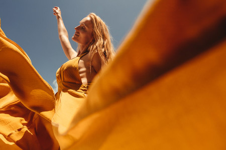 Relaxing woman in summer maxi dress