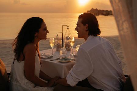 Couple having dinner at a beach